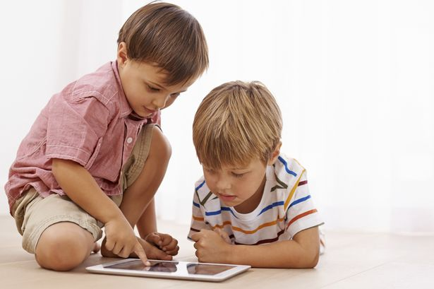 Kids-playing-on-digital-tablet-device.jpg
